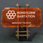 Sign J (Honeycomb Habitation) with stand